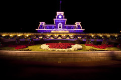 Christmas Train Station at Night (tltichy) Tags: christmas longexposure holiday night canon garden orlando purple florida entrance disney trainstation mickeymouse wdw waltdisneyworld magickingdom 5dmarkii 5d2