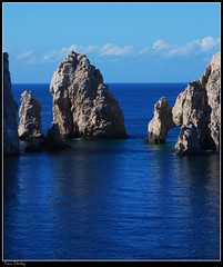 Dreamin' (raul_the_truck) Tags: ocean blue sea vacation sun water beautiful rock cabo nikon arch pacific reflect picnik