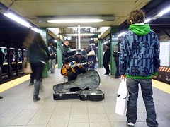 Blues for Christmas (Roblawol) Tags: christmas nyc newyorkcity subway guitar blues singer mta busker unionsquare unionsq bystanders 2010 onlookers 14thstreetsubway december18 121810
