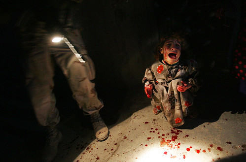 Army unit killed the parents of this blood-spattered girl at a checkpoint, when the photo was published, Hondros was kicked out of the unit, Tal Afar, by Chris Hondros 2005