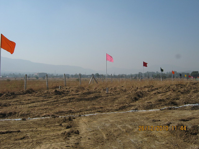 Flags on the Boundary of Majestic  NA Bungalow Plots:  at Kanhe Phata - near Vadgaon - Talegaon, walking distance from Kanhe Railway Station, on Old Mumbai Pune Highway (NH 4)