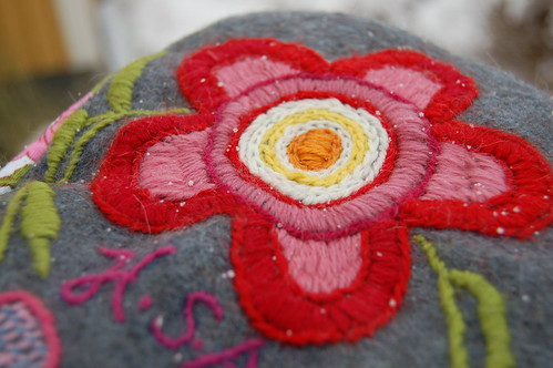 Red and pink wool flower