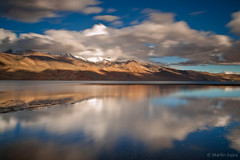 Reflection on Lake Tso Moriri ~ Ladakh, India (Martin Sojka .. www.VisualEscap.es) Tags: blue sky india lake mountains reflection nature colors landscape rocks hill vivid olympus filter lee zuiko gitzo e30 ladakh 2010 tsomoriri lightroom zd 1260mm bigstopper