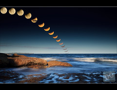 The 2010 Summer Solstace Lunar Eclipse (David de Groot) Tags: ocean sea moon beach composite canon evening eclipse rocks waves sydney australia nsw newsouthwales canonef1740mmf4lusm cronulla flickrsbest canonef400mmf56lusm canonef14xteleconverter 5dmkii christmastriptosydney 1dmkiv