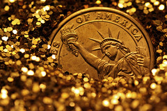 Liberty, Buried In Gold (matthileo) Tags: light money sparkles glitter america liberty gold freedom golden coin coins dollar statueofliberty goldendollar