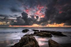Smoldering (Nick Twyford) Tags: longexposure sunset newzealand seascape storm night clouds nikon rocks waves wideangle nopeople auckland nz northisland westcoast lastlight d800 waiuku singleimage colourimage awhitupeninsula leefilters hamiltonsgap lee09nd lee06gndsoft phottixgeoone nikkor160350mmf40