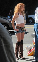 cowgirl with boots and a BIG beltbuckle (bballchico) Tags: shaketheshackcarshow hotrods customs seattle shantytavernandroadhouse cowgirl redhead boots beltbuckle 206 washingtonstate