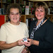 Rose Marie Comeau receives her iPod Shuffle