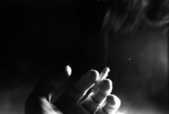 International Hello (Immane) Tags: blackandwhite film monochrome 35mm hand cigarette smoke trix 400tx d76 135 pushed pushprocessed supertakumar ei800 pentaxspotmaticii 55mmf18 roll59 aristapremium400