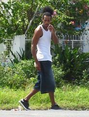 Second Thoughts (Legin_2009) Tags: road street man black male men guy hair walking shoes walk african guys sneakers jeans tanktop males caribbean shorts hombre wifebeater homme mec homens singlet topknot muscleshirt mecs