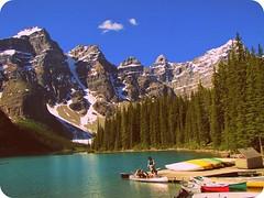 Outing at Moraine Lake (jimsawthat) Tags: sky lake canada mountains canoe banffnationalpark morainelake canadianrockies ebhanced