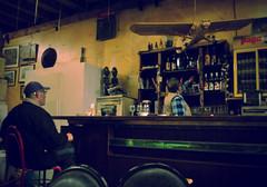 pause de midi...jusqu'à 15h (Oulalla) Tags: man café bar vintage nikon dos alcool effect chaise homme barman bouteilles d60 vignetage