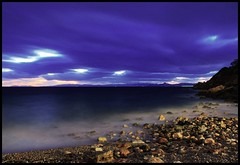 Night befalling (n.pantazis) Tags: longexposure light sea sky beach night clouds dark evening coast twilight ship dusk dramatic stormy shore 1minute cloudysky saronicgulf pentaxkx vouliagmeni kavouri 60seconds 60sec saronicos