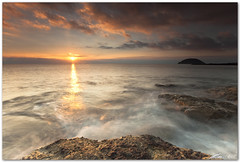here comes the sun (chris frick) Tags: chrisfrick canoneos5dmark2 wideangle tripod gitzo ballhead longexposure lee filter 09nd 075gndhard mediterraneansea seascape sea sunrise morning dusk sunstar albenga isolagallinara liguria italy rocks clouds canon1635mmf28liiusm bravo