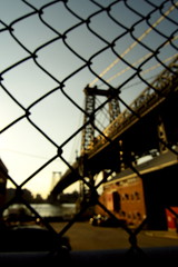 Williamsburg Bridge (Airicsson) Tags: street new york city nyc bridge sunset summer sky urban usa ny island us bokeh walk manhattan fences williamsburg 2010 streetshot lx3