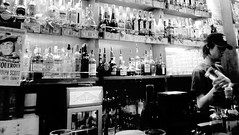 22/365: Pour (joyjwaller) Tags: blackandwhite cute guy japan bar tokyo bottles pour regular excellentservice project365 mexicanbar thecantinatakadanobaba