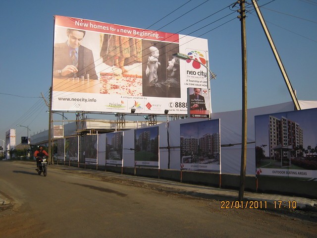 Visit to Neo City 1 BHK & 2 BHK Flats at Wagholi Pune 411 027 - site hoarding of Neo City (www.neocity.info)