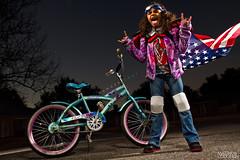 023/365 Danger Zone (matthewcoughlin) Tags: girl bike danger kid goggles sigma americanflag speedlight zone rockon sillykid dangerzone strobist 430exii canon7d 3652011 2011inphotos