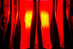 Fire in the red - Scuderia Ferrari (forceberg) Tags: lighting red macro cup glass car promotion fire 50mm gold nikon focus hungary flash creative shell sigma ferrari racing ring mf manual dslr promotional scuderia diffuser 2010 d60 vpower strobist yongnuo yn465 4ceberg forceberg