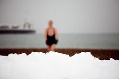 snow in a shallow depth of field (lomokev) Tags: winter sea snow cold beach pier focus brighton dof depthoffield brightonpier palacepier deletetag snowyswimnov2010 file:name=101202eos5d9992