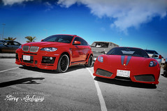Ferrari 430 Scuderia VS  BMW X6 Hamann (Tareq Abuhajjaj | Photography & Design) Tags: red sky italy cloud speed nikon flickr top fast ferrari turbo arab saudi arabia bmw vs 70200 scuderia v8 vr 430 hamann garmany x6 tareq d700 tareqmoon tareqdesign abuhajjaj