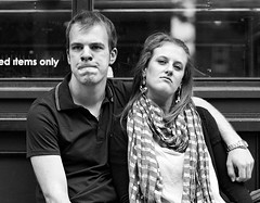 050910_d700_n105_3181 (jugglingsoot) Tags: couple arm watching smug lips lovers shoreditch grimace frustration embrace shoulder bricklane leaning spitalfields tense nostrils slouch flared complacent pursed
