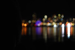 316/365 - Dreaming In Color ( Stormchild) Tags: city canada reflection water silhouette night vancouver bc bokeh citylights hood englishbay 365 manualfocus westend kitsilanobeach project365