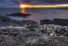 God's Flashlight (Brandon Godfrey) Tags: ocean pink blue light sunset sky orange usa sun seascape canada detail reflection beach nature water beautiful yellow clouds photoshop reflections landscape puddle outdoors fire photography coast amazing rocks colorful glow bc outdoor dusk britishcolumbia sony details horizon unitedstatesofamerica tripod logs rocky overcast victoria canadian vancouverisland reflected driftwood flare pacificnorthwest northamerica glowing rays colourful alpha dslr washingtonstate puddles westcoast beams hdr highdynamicrange foreground oakbay olympicmountains a300 salishsea tonemapped gonazales tonemapping surfscoters cs5 straightofjuandefuca harlanpoint photomatixpro4