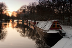 Hibernation (Grand Union Canal), Rickmansworth (flatworldsedge) Tags: trees winter sunset orange snow water boats canal day bare union silhouettes grand glossy curve barges rickmansworth explored yahoo:yourpictures=winter yahoo:yourpictures=winterv2 yahoo:yourpictures=reflections2