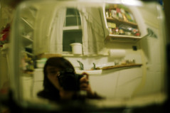 this is worrisome (featherladder) Tags: selfportrait kitchen distorted angst unraveling