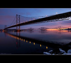 The Forth Road and Rail Bridge (Billy Currie) Tags: road morning bridge snow reflection water rock night canon dark dawn scotland glow crossing suspension mark transport rail railway estuary og forth ii 5d redsky colourful tidal span lothian welcomeuk