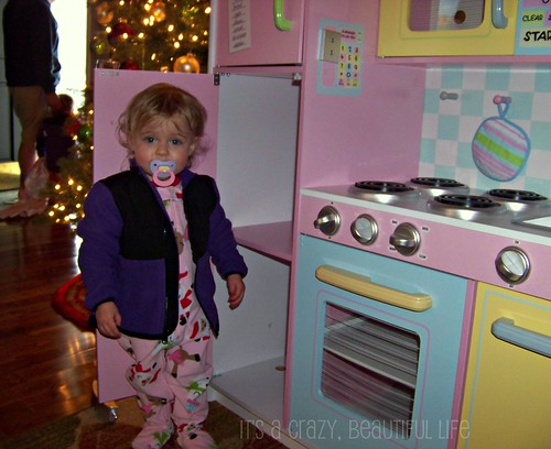 Checking out her kitchen and wearing her new jacket