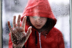 Under the Rain (Lou Bert) Tags: red portrait window girl rain self hoodie hand drop
