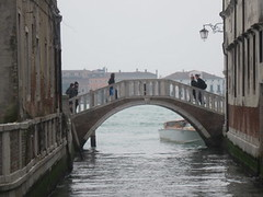 people walking on venice bridge
