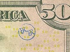 """""""R R"""" chop on $50 bill"""