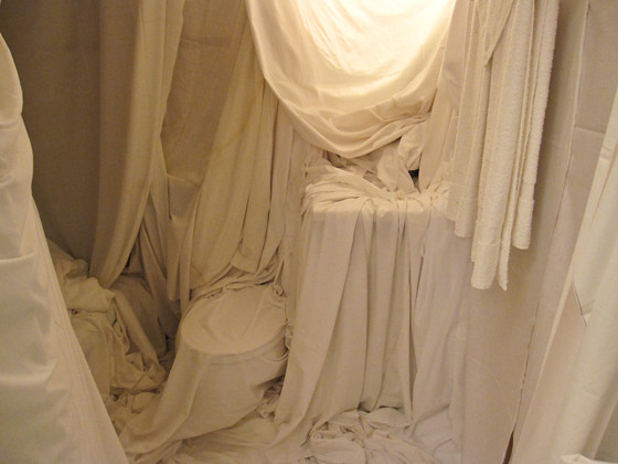 Room 103 draped in sheets
