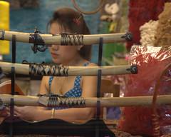 Hidden beauty (Farangrakthai) Tags: woman girl beauty shop canon asian thailand magasin market bangkok femme thai 7d sword samurai fille asiatique chatuchak 24105mm jatuchak eurasienthaicom farangrakthaicom