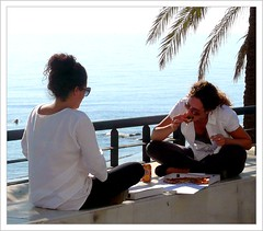 Lunchtime in Marbella , Spain . (Franc Le Blanc .) Tags: girls people beach lumix spain sitting eating candid panasonic pizza sit streetphoto seated marbella