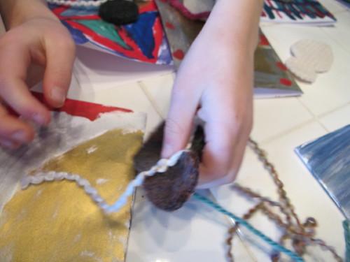 Peelu tying a snowman scarf