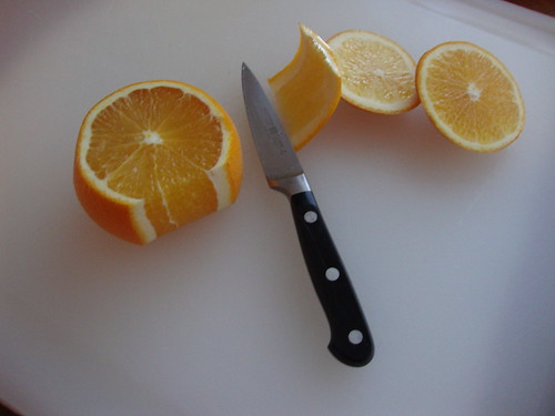 Separate the meat from the tough bitter skin and pith by cutting downward with the knife from the top of the fruit the bottom.