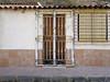 la algameca (maximorgana) Tags: laalgameca door window reja uralita mountain pavement dirty trashbit rusty monochromatic