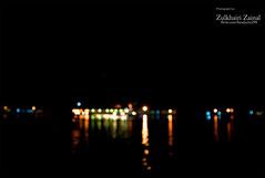 Blur is Art #2 (Zulkhairi Zainal) Tags: longexposure pink blue red sky black art water buildings nikon bokeh twinkle nano brunei f4 knk manfrotto woodenhouses bandarseribegawan 1635mm blurshot vrii kampungair starsinthesky d700 nikonflickraward