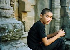 "Cambodia #16: the ""Roulos"" boy (zane&inzane) Tags: leica boy man film monument temple 50mm kid cambodia cambodian khmer kodak voigtlander ruin monk angkorwat architectural negative angkor archeology m6 nokton 400vc roulos roulous 50f15"