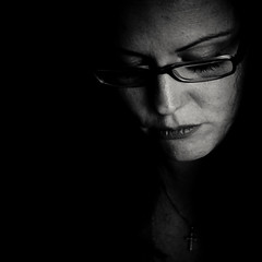 En quarantaine (Christine Lebrasseur) Tags: portrait people blackandwhite woman white black france art 6x6 face canon dark sadness glasses eyes closed fr lowered virginie onblack highangle dimmed gironde 500x500 challengeyouwinner saintloubes allrightsreservedchristinelebrasseur