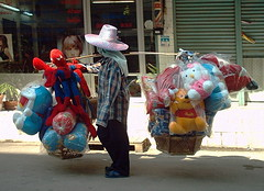 another tough way to make a living (the foreign photographer - ) Tags: hello street mobile thailand toys stuffed bangkok spiderman kitty pillows doraemon vendor bangkhen