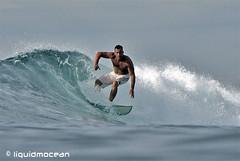 Distant Surfer (liquidmocean) Tags: bali surfing surfspot waterhousing seranganisland