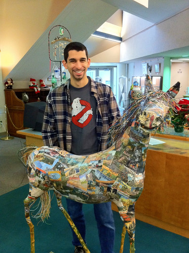 "Library IT Assistant Manager Nathan Miller admires ""Florida Cracker,"" by Mindy Colton, at the Go Green exhibit."