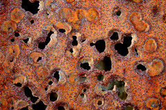 Perforated (mind the goat) Tags: red top20decay rust hole decay steel oxidation thin corrosion perforation oxide corrode