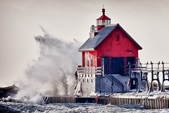 Winter  Rage (James Marvin Phelps) Tags: winter lighthouse storm photography waves michigan lakemichigan hdr grandhaven jmpphotography jamesmarvinphelps grandhavenpierlight