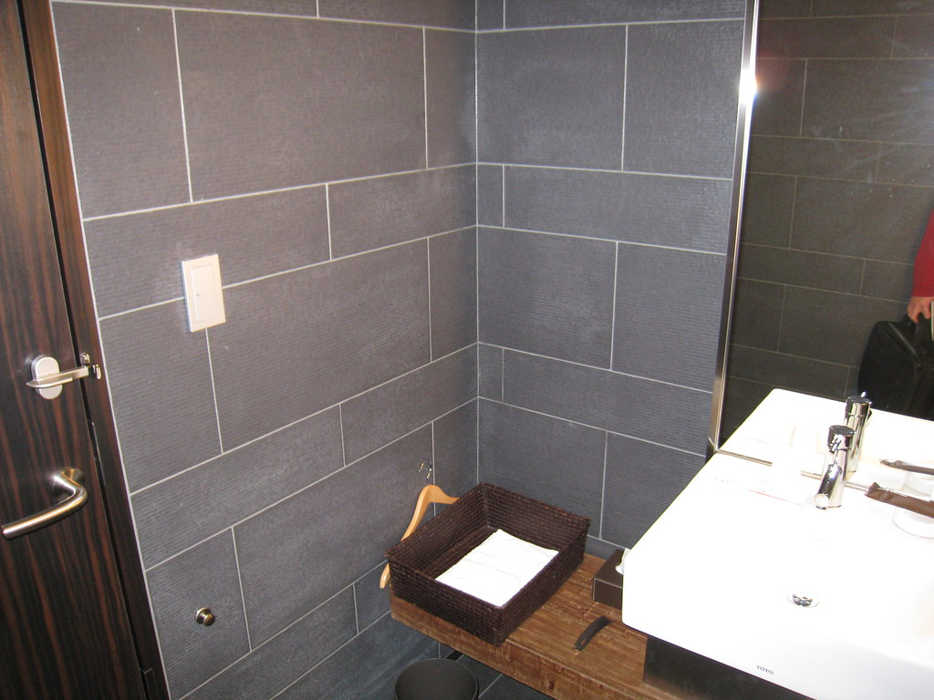 Small shower room at JAL First Class and Sakura Lounge